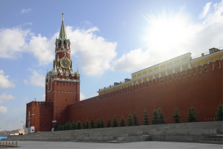 Bright sunshine over the Moscow Kremlin. Clear sky and a dazzling cloud.