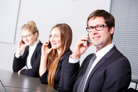 Business people having phonecall in meetingの写真素材