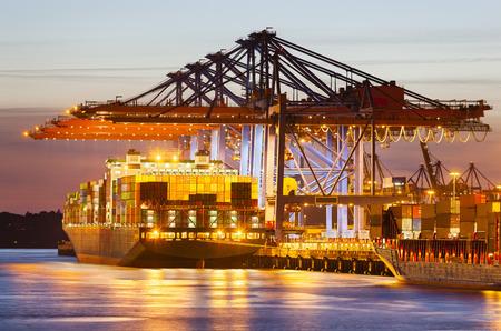 Container ship at a terminal at dusk