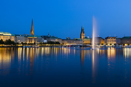 The famous Binnenalster lake with its fountain in Hamburg, Germany at night
