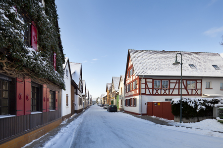 Old Houses In A Small German Village With Snow And Blue Sky At