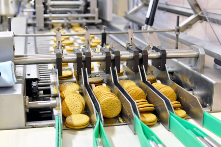 Photo for conveyor belt with biscuits in a food factory - machinery equipment  - Royalty Free Image