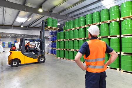 Photo pour group of workers in the logistics industry work in a warehouse with chemicals - image libre de droit
