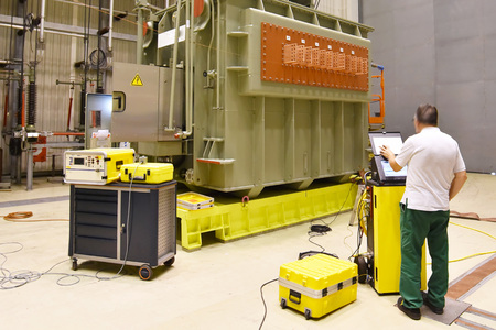 Scientist operates a research facility in the industry: machine for the production of artificial flashes - pilot plant in mechanical engineering