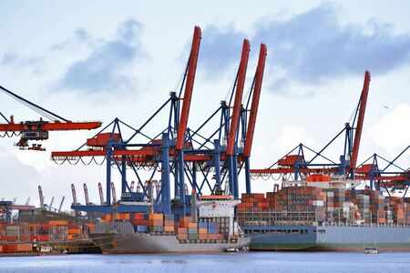 Photo for transport and logistics by water - loading of ships in a port with goods for export  - Royalty Free Image