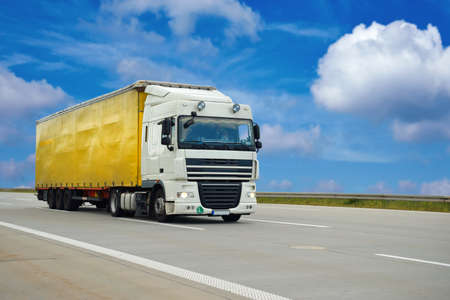 Photo for Road transport of goods by lorries - trade and transport - Royalty Free Image
