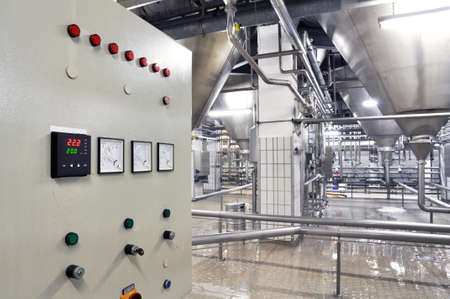 Photo pour Industrial plant in a modern brewery - technology in a factory building with pipes and fittings - image libre de droit
