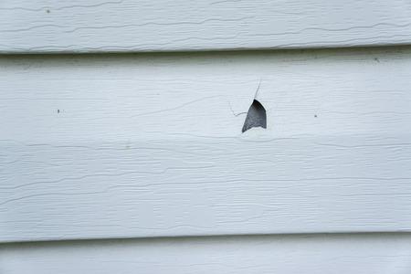 Photo pour Hail damage on vinyl siding of a house. - image libre de droit