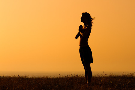 Photo for Silhouette of a woman meditating. - Royalty Free Image