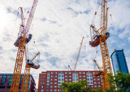 Photo pour MONTREAL, CANADA - JUNE 17, 2018: Multiple cranes are set up downtown for a large construction project. - image libre de droit