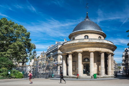 Paris, France - August 14, 2016: Parc Monceau is a public park situated in the 8th arrondissement of Paris. At the main entrance is a rotunda. The park covers an area of 8.2 hectares.