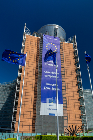 Photo pour Brussels, Belgium - May 5, 2018 : European flags in front of headquarters of European commission in Brussels in summer day - image libre de droit