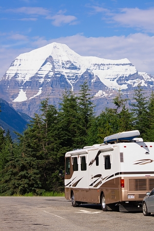 Recreational vehicle before mountains