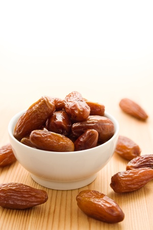 Sweet dates in a white bowl