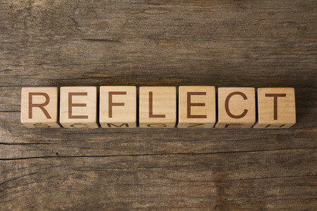 REFLECT word on a wooden cubes