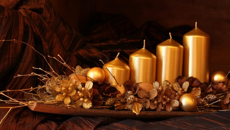 Modern gold advent decoration with four candles. Shallow dof