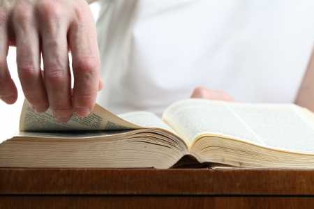 Man turning the page of the Bible. Shallow dof