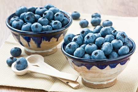 Two cup with ripe blueberry for healthy breakfast