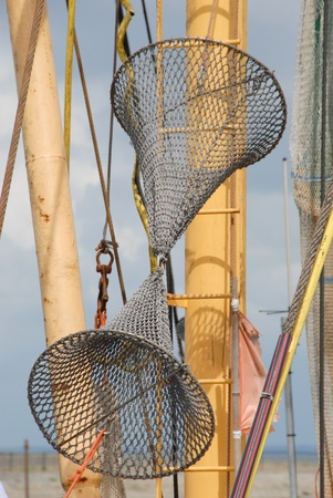 Fishing utensils at a mast of a fishing trawler