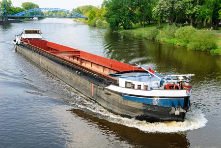 Cargo ship on the river Weser near Nienburg