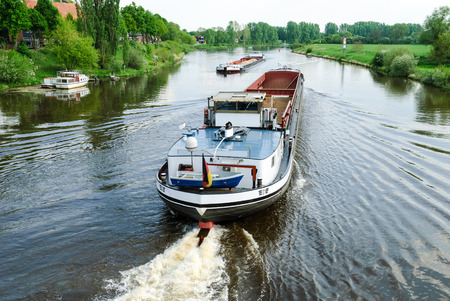 Two cargo ships on the river Weser meet near Nienburg