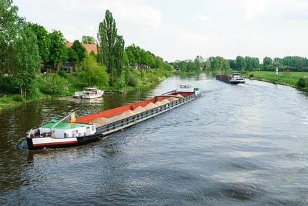 Two cargo ships on the river Weser near Nienburg