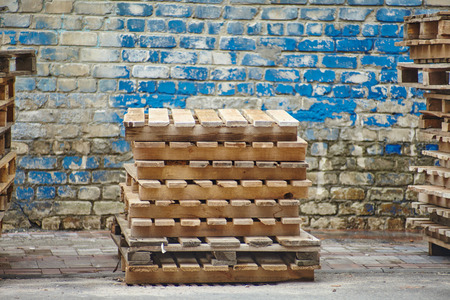 Wooden pallets on background wooden wall