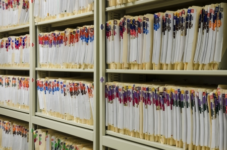 Shelves filled with colorfully labeled  medical files