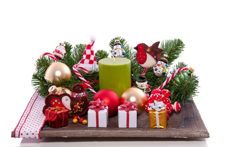 cheerful christmas decoration on a wooden plateau isolated over white