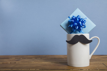Photo for Father's day present with a coffee mug and paper mustache - Royalty Free Image