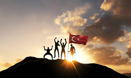 Photo pour A group of people celebrate on a mountain top with Turkey flag. 3D Render - image libre de droit