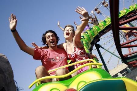 Teenage couple on roller coaster
