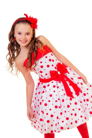 pretty little blonde girl in a polka dot dress  positive portrait  isolated on white background