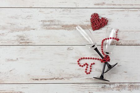 Photo for Valentines day romantic background - red heart, glasses with bead chain. Holiday dinner concept. Top view. Copy space. - Royalty Free Image
