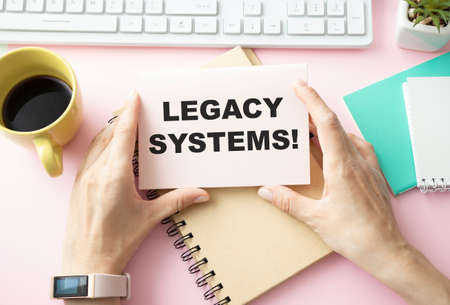 Photo pour Writing text showing Legacy Systems. Business concept for Upgrade SOA Application written on sticky note paper on wooden background with pen, marker - image libre de droit