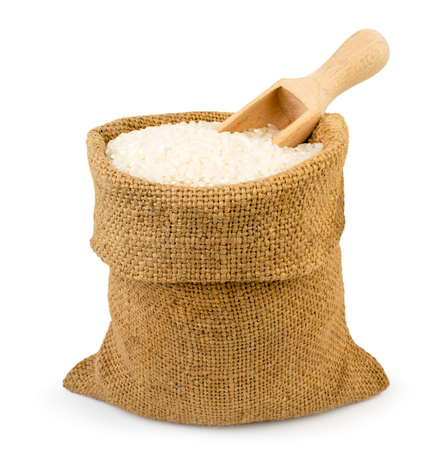 Foto de Bag of rice and wooden spoon on a white, isolated. - Imagen libre de derechos