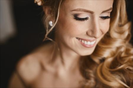 Foto de Young happy bride with closed eyes and with stylish wedding hairstyle - Imagen libre de derechos