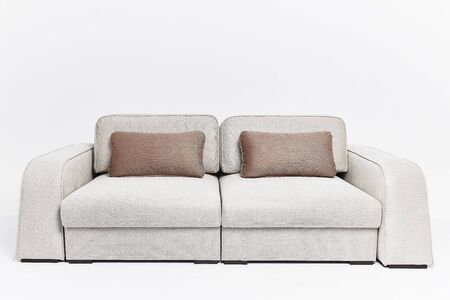 Photo pour The beige couch in modern style with two brown pillows isolated on white background - image libre de droit