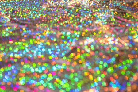Photo pour Abstract blurred of silver glittering shine bulbs lights background. Sparkle silver colorful glittering background. Real defocused lights. - image libre de droit
