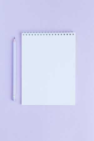 Photo for Notebook with blank page and pencil on a violet background. Flat lay. Place for text.  - Royalty Free Image