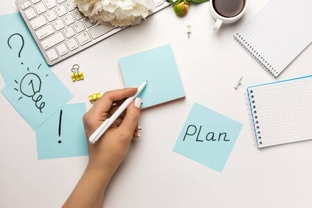 Photo for Businesswoman In search of new ideas, marks written reminders sticky notes on office desk on white background top view. Ask or business concept. - Royalty Free Image