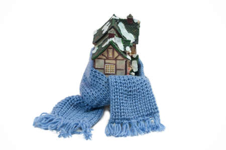 Christmas toy house wrapped in blue hand made shawl