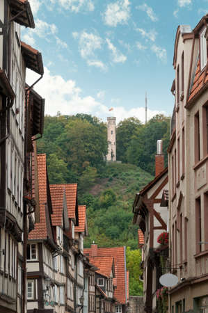 Beautiful narrow street with half-timbered houses in Old German Town