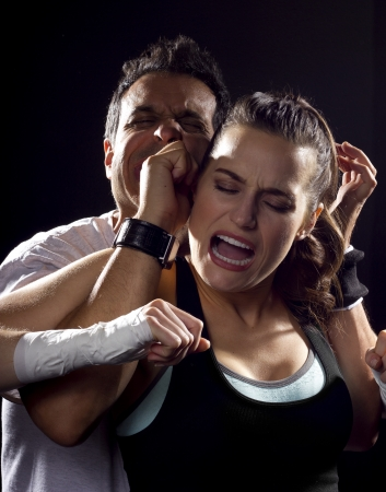 young fit woman fighting a man