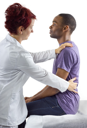 young female therapist consulting male client about posture