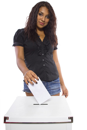 Latin female voter at the ballot box  Isolated on a white background