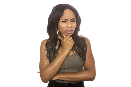 Photo for Black female isolated on a white background displaying facial confused expressions.  She is young and of African American ethnicity. - Royalty Free Image