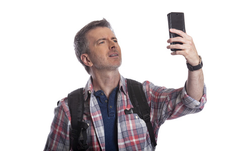 Photo pour Tourist or traveling hiker unable to get cellphone reception or network.  The man can't make a call or get a rideshare because he has no service or internet. Isolated on a white background. - image libre de droit