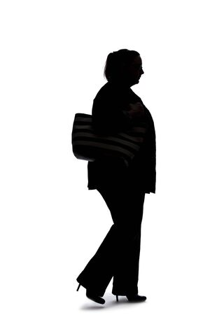 Photo for Silhouette of a curvy or plus size businesswoman on a white background.  She is posed like she is walking in side view. - Royalty Free Image