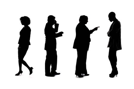 Photo pour Silhouettes of a group of workers depicting a company or networking event.  The businessmen and businesswomen are unrecognizable and anonymous and represents an office team or staff. - image libre de droit